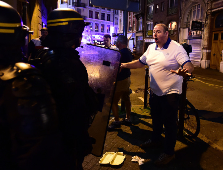 Riot police charged a group of several hundred supporters who were setting off flares outside a pub last night.
