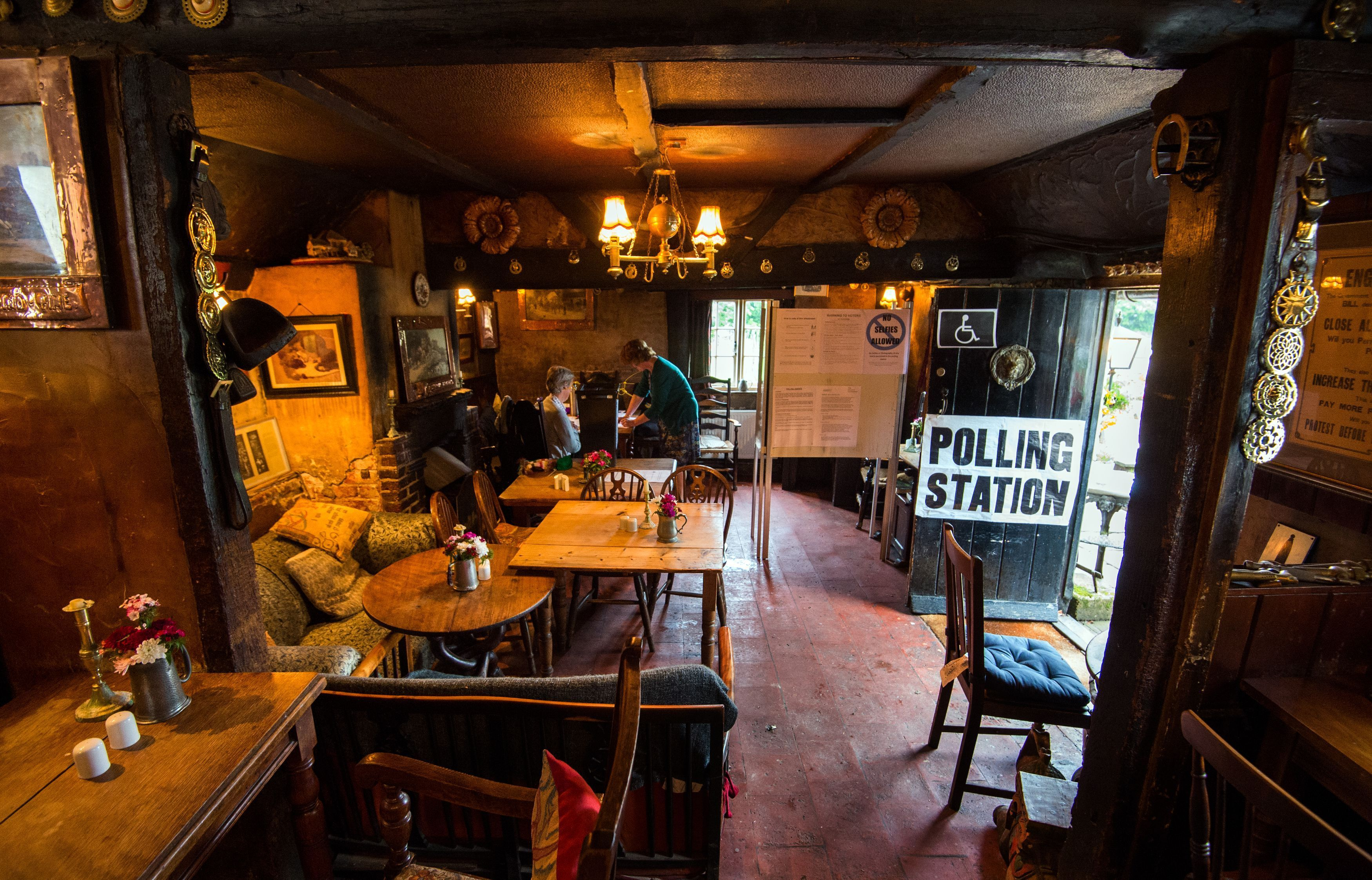 "The White Horse Inn in Priors Dean, Hampshire — also known as the ""Pub with no name"" — serves as a polling station."
