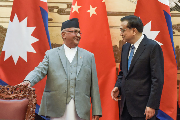 Nepal's Prime Minister K. P. Sharma Oli (left) and Chinese premier Li Keqiang in Beijing in March.