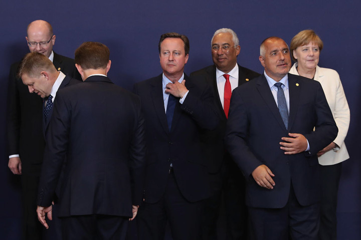 British Prime Minister David Cameron waits for the group family photo with the European Council in Brussels.